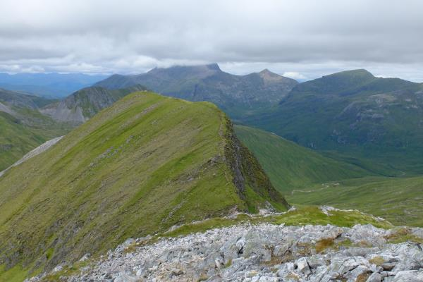 Photo of 1,036 metre flat top of Na Gruagaichean with Ben Nevis behind