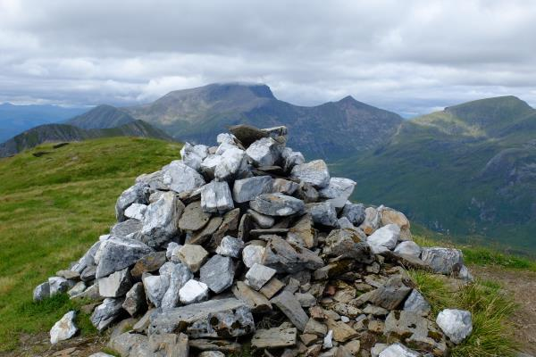 Photo of Top of Na Gruagaichean 1,036 metre flat top with Ben Nevis in background