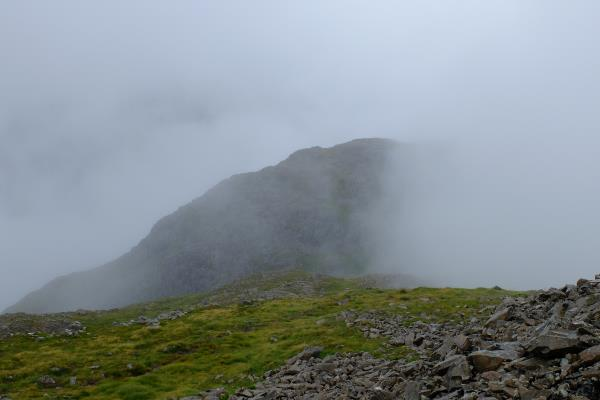 Photo of Aonach Dubh starting to appear from the mist