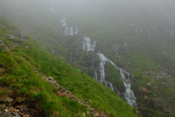 Photo of Waterfalls from Coire nan Lochan filling up after recent hot weather