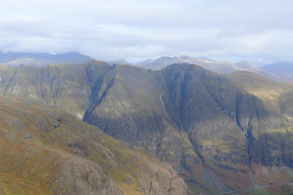 Photo of Distant views of Ben Nevis to left in the clouds and Grey Corries in middle