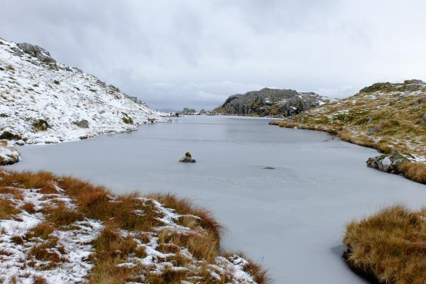 Photo of Partially iced lochan on Creag Ghorm