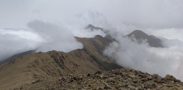 Photo of Looking along ridge from Adrar n'Ouhattar with mist forming
