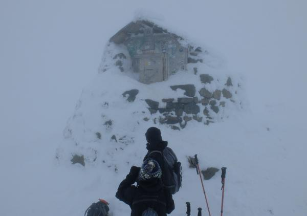 Photo of Clients looking at summit shelter