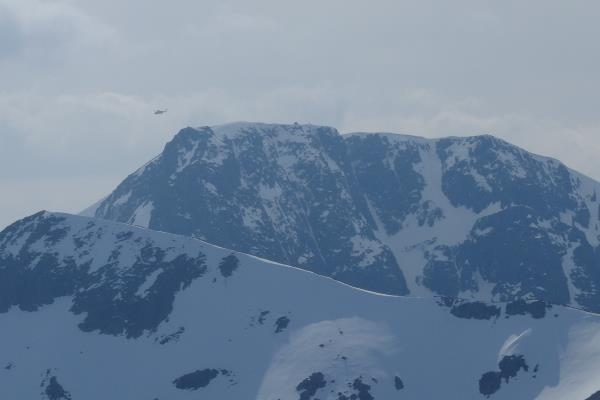 Photo of Helicopter leaving the summit of Ben Nevis