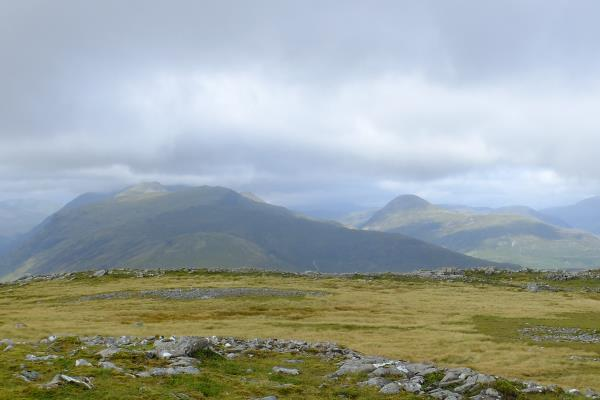 Photo of Aonach Eagach ridge on left and isolated Garbh Bheinn to right
