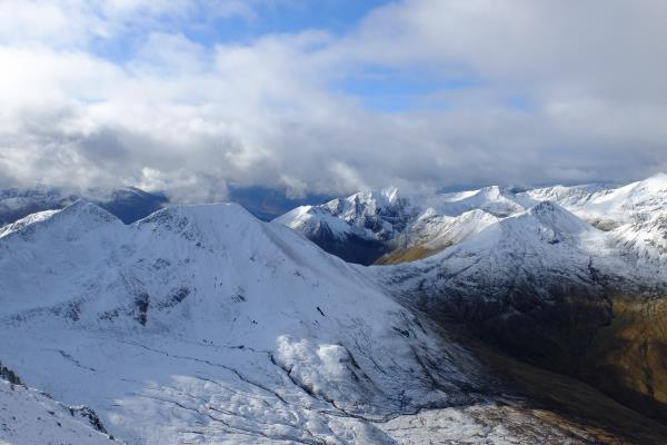 Photo of Twin peaks of Na Gruagaichean on left leading to Stob Coire a' Chairn