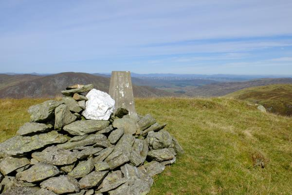 Photo of Cairn and trig point at the top of Meall Tarsuinn